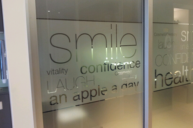 Wolf_Signs_Window_Graphics_Frosted_Smile_B